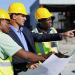Lavoratori di imprese emiliane in un cantiere.