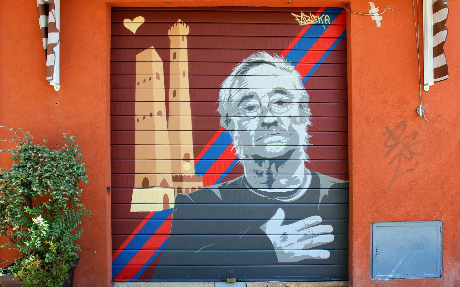 Bellezza urbana a Bologna: un murales di Lucio Dalla su una serranda