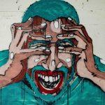 Murales di un uomo sconvolto, con le mani nei capelli.