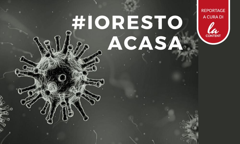 L'hashtag #iorestoacasa, con un immagine del virus.