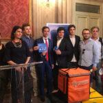L'assessore Marco Lombardo e i rappresentanti dei riders alla firma della Carta di Bologna.